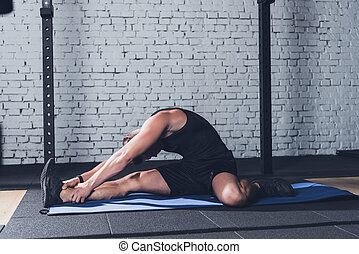 man stretching on mat