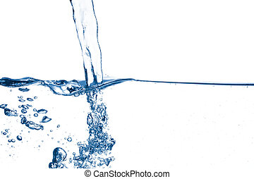 Side view of strong stream of water going under surface and creating bubbles on white background