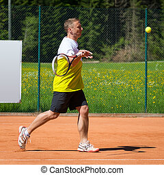 side view of tennis player hitting a forehand