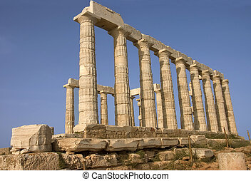 side view of the Greek temple of Poseidon (c. 449 B.C) god of the sea in Cape Sounion , Greece