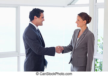 Side view of trades partner shaking hands