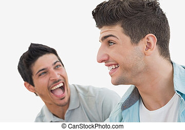 Side view of two excited soccer fans over white background