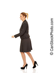 Side view of walking business woman