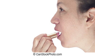 Side-view of Woman Applying Lipstic
