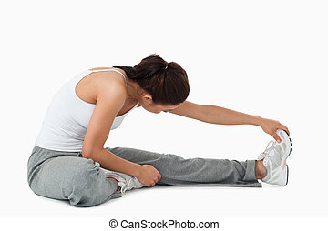 Side view of woman doing stretches