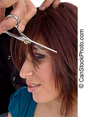 side view of woman getting haircut