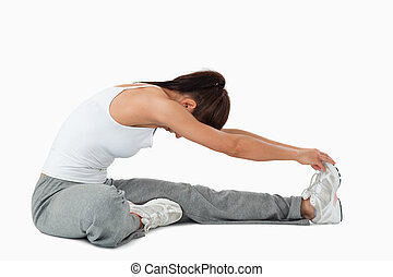Side view of woman stretching