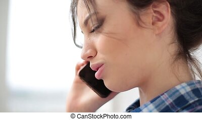 side view of woman talking phone. Close up