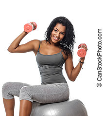 . Side view of wooman sitting on fitness ball.