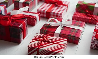 Side view of wrapped Christmas presents laid on the wooden...