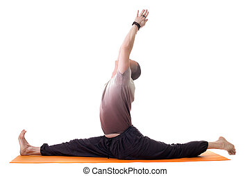 Side view of yoga trainer posing on split, isolated over white background