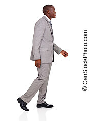 young african american businessman walking