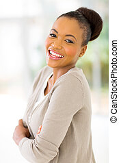 young african businesswoman with arms crossed