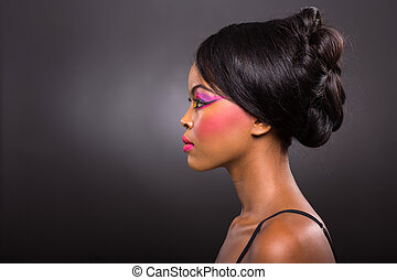 young african woman with colorful make-up