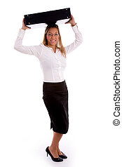 side view of young businesswoman putting briefcase on her head