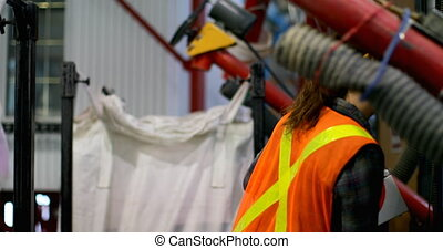 Side view of young caucasian female worker checking stocks ...