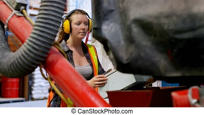 Side view of young caucasian female worker working in ...