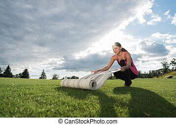 woman preparing for doing yoga