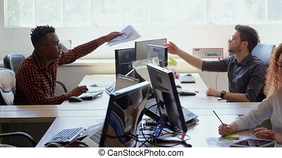Side view of young cool mixed-race business team working at desk in a modern office 4k