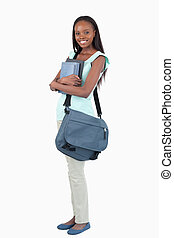 Side view of young female student ready for class