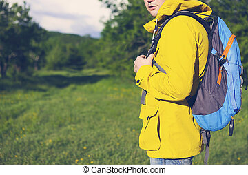 Side view of young man with backpack hiking