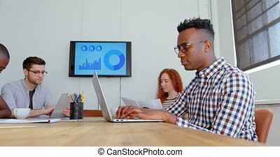 Side view of young mixed-race business team working in meeting room of modern office 4k