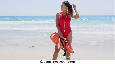 Side view on woman in red with buoy - Side view on beautiful...