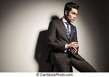 elegant business man looking away from the camera