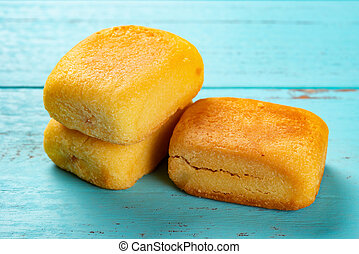 side view pineapple cakes on blue background