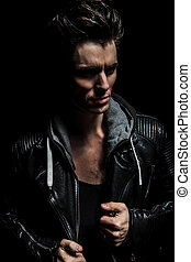 side view portrait of a dramatic man in leather jacket