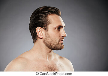 Side view portrait of a sexy shirtless man looking away