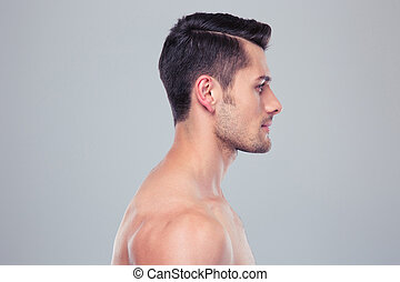Side view portrait of a young muscular man