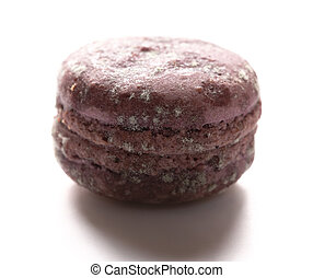 side view purple moldy macaroon on a white background