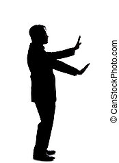 Side View Silhouette of a Businessman Using Hands for Stop ...