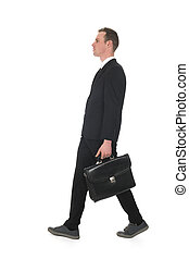 Side view walking business man with briefcase