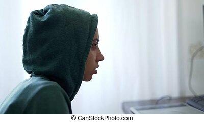 side view woman programmer freelancer hacker in hoodie ...