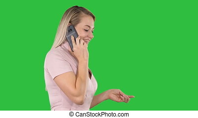 Woman talkin on the phone on a Green Screen, Chroma Key.