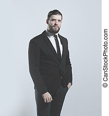 side view.portrait of a serious businessman.isolated on grey background