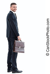 side view.portrait of confident businessman looking at the camera.