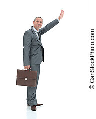 side view.smiling businessman making a hand stop gesture