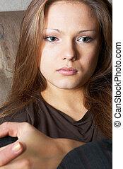 sidelong glance of peaceful pretty girl