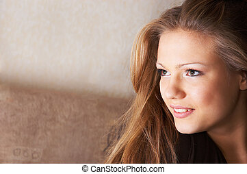 sidelong glance with smile - portrait of pretty young woman...