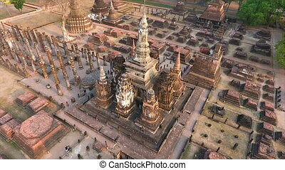 A high angle shot of the sideview of structures in an old temple of buddha in Sukhothai, Thailand