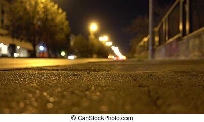 sidewalk and blurry cars on motorway - Sidewalk and blurry...