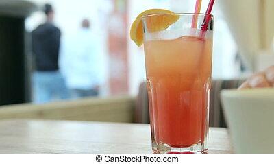 Sidewalk Cafe - Woman drinking fresh at sidewalk cafe