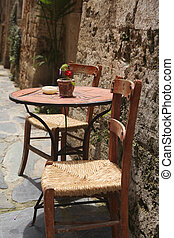 Sidewalk cafe  - Table and chairs on sidwalk cafe in Greece