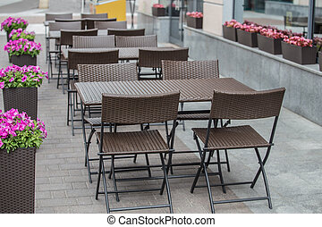 Sidewalk cafe without people on the street in the city ...