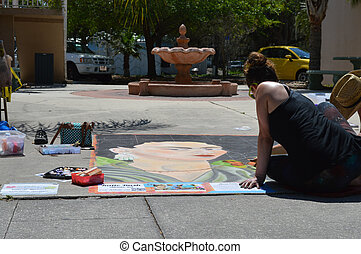 Sidewalk chalk art with fountain - This is a photo of an...