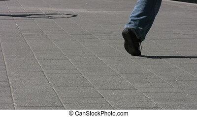 Sidewalk Circle Action - Cyr Wheel - A man using a Cyr Wheel...
