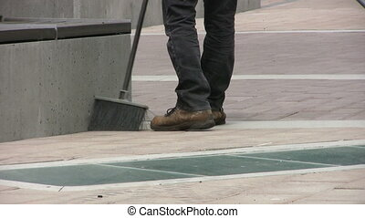 Sidewalk Cleaner - A sidewalk cleaner cleans up a plaza area...